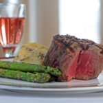 steak dinner with mashed potatoes and asparagus