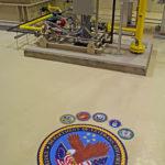 HVAC equipment with Department of Veterans Affairs seal on floor