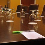 Courtyard Marriott conference table with glasses pens and pads