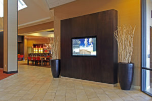 television in hotel lounge with cafe in background
