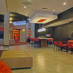 empty hotel lounge with orange decor