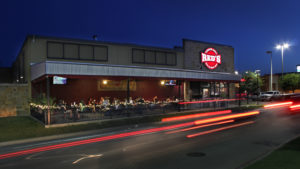 Reds Corner Grill exterior time exposed with taillights at night