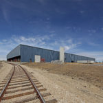 exterior shot of commercial building with railroad loading access