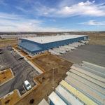 crane shot of commercial building 18 wheeler loading dock