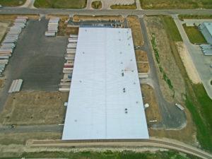 crane shot of commercial building roof