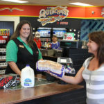 CEFCO convenience store cashier with customer
