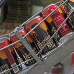 BJs red ale beer cans on assembly line