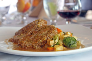 pork and brussel sprouts dinner plate