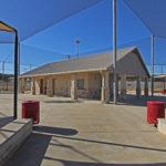 empty concession area in center of baseball field complex