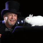 magician portrait with bubble and white rabbit