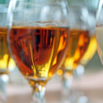 closeup of white wine glass with reflection