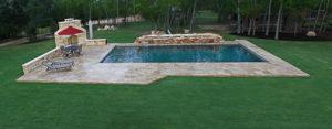 backyard pool in wooded yard