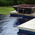 water feature in backyard pool
