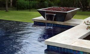 water feature in backyard pool