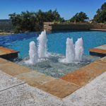 fountain feature in backyard pool with infinity edge