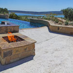 backyard pool with hot tub and fire pit overlooking lake