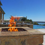 fire pit closeup with pool and hot tub in background