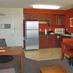 kitchenette inside hotel room