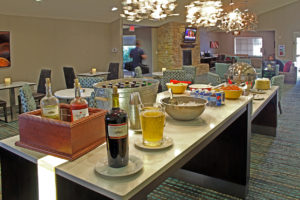 hotel lounge with drinks and buffet