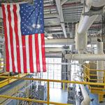 American flag flying inside factory