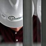 Greenland Enterprises hard hat employee looking down