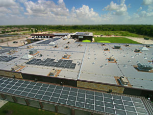 roof of commercial building showing HVAC and solar panels
