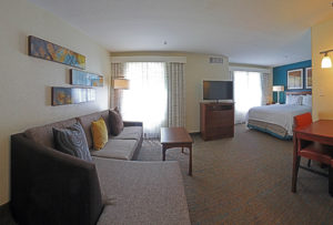 hotel room with couch and bed
