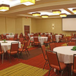 empty hotel conference room with banquet setup