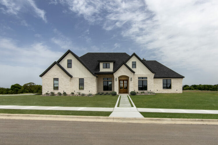 exterior of home with white brick and black trim