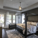 bedroom furnished with canopy bed and gray color scheme