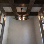 dark woodwork ceiling with fan