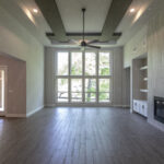 living room unfurnished with tall ceilings and built-in fireplace