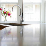 stained kitchen countertops with reflection