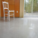 stained concrete floor with white chair