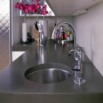 stained concrete kitchen counter with sink