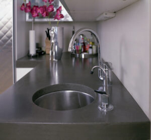 closeup of stained concrete kitchen sink