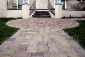 paved stone walkway leading to house
