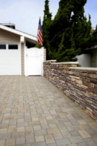 stonework wall and paved stone drive in driveway