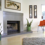 living room with stained concrete fireplace