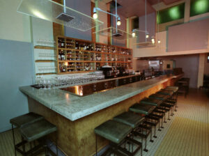 wide angle of wine bar with stained concrete bar